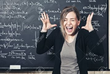 16543013-portrait-of-stressed-teacher-and-blackboard-background-Stock-Photo